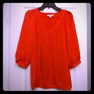 Silky bright orange blouse